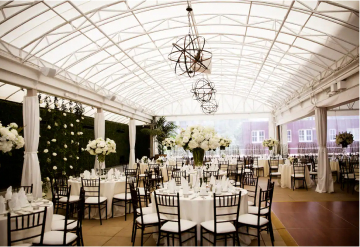 Linens and floral arrangements at a wedding on the Veranda