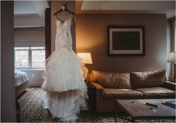Wedding dress hanging in a guest room