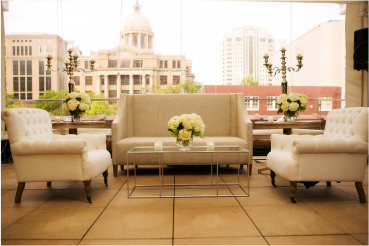 Lounge area with sofas and downtown Houston in the background